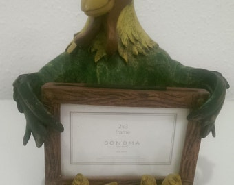 Hand painted, clay chicken, holding a 2x3 picture frame