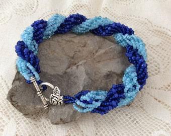Dark and light blue woven bracelet
