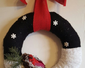 Rustic, handmade holiday yarn wreath with bird's nest