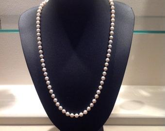 Preloved cultured pearls
