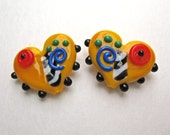 Handmade Whimsical lampwork yellow heart beads matched pair