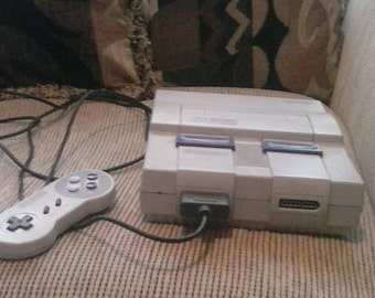 Super Nintendo plus hard to find Nintendo mouse