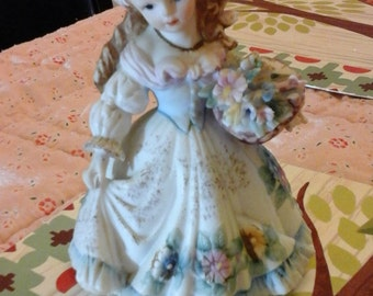 "Lefton China figurine ""Girl with Flowers"""