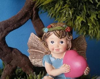 Fairy holding a Heart