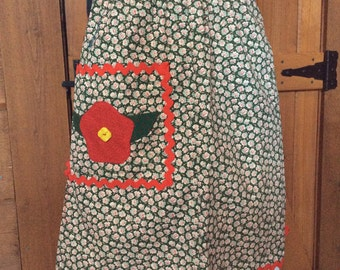 Apron with appliquéd Rick Rack trim pocket.