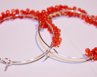 Orange beaded cluster hoop earrings