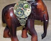 Steampunk bracelet-cuff,Gustav Kimt style, filigran, watch pieces, green & red Swarovski flat crystal cabs  and gears  in black polymer