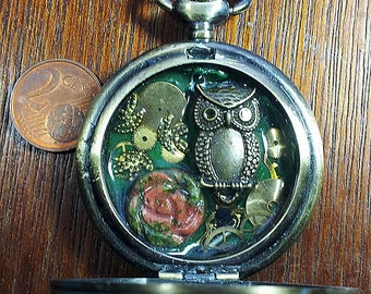 Steampunk pendant made of a pocket watchcase  gears, a nice unakite flower, incristal resinb4h0-029