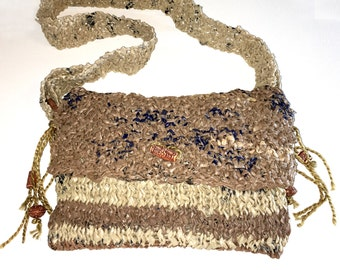 1 Brown/Tan/Black plastic purse with bead and wood detail Item: #2