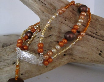 Orange, Gold & Brown Beads with Brown Sea Glass Bracelet