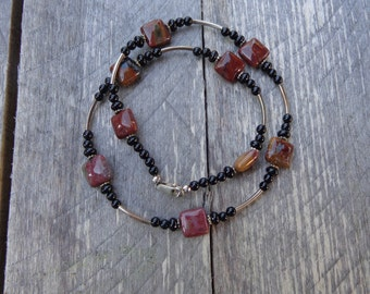 Brecciated jasper, onyx and sterling silver beaded necklace.
