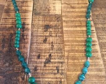 Dark green long beaded necklace