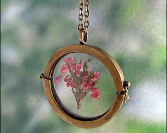 Real Heath blossoms in a glass Locket