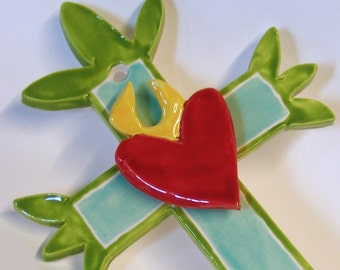 whimsical Ceramic Cross with sacred heart with flame, Mexican folk art, turquoise aqua, lime green
