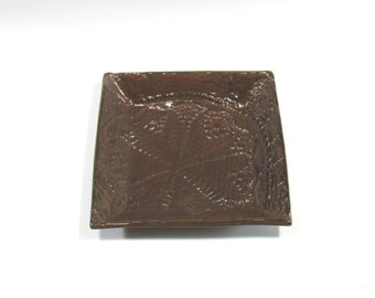 Square Sandwich Plate with Raised Pattern in Dark Reddish Brown Glaze