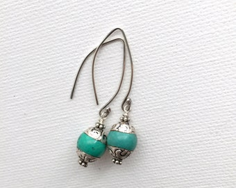 Tibetan Silver Turquoise Earrings. Turquoise Capped with Tibetan Silver and Sterling Silver
