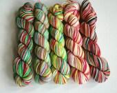 Hand dyed mini skeins. 5 x 20g Alice in Wonderland sock yarn sets. Variegated yarn. Superwash merino/nylon 4ply/fingering weight. Knitting.