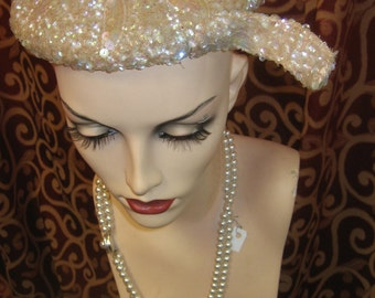 "1950's, 23"" round, of pink champagne colored sequins"