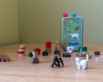Tiny toys in a wee tin box with dog, cat, and monkey. Fun collection of random toys for kids. Busy box, activity tin.