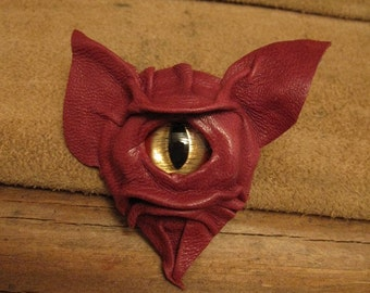Grichels leather pin/tie tack/brooch - dusty red with red and gold slit pupil shark eye