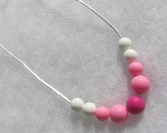 Silicone Teething Necklace. Pink and white. Silk cord. Snap safety closure.