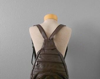 vintage leather dark brown small sling backpack purse / adjustable straps / travel bag
