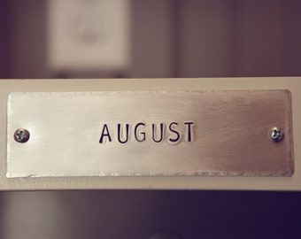"""Handstamped Aluminum Name Plates. Two sizes available: 1"""" x 4"""" and 1.5"""" x 5"""""""