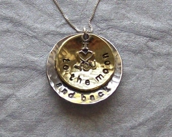 I love you to the moon and back pendant necklace made of handmade hammered and cupped brass and aluminum discs on a sterling silver chain.