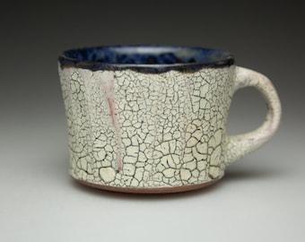 blue glazed and cracked surface ceramic  pottery mug cup
