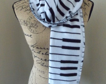 Piano Scarf, fleece scarf with piano keys on one side and sheet music on the other, black and white piano keys and treble clef, music gift