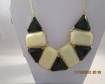 Gold Tone Chain Necklace with Black and Ecru Pendants