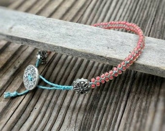Waxed linen bacelet. Czech glass bracelet. Woven waxed linen and czech glass bracelet. Turquoise and peach bracelet. Turquoise waxed linen.