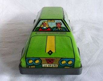 Just married, not! Vintage tin toy family car, Turkish. 1970s French Renault 12 TS auto, station wagon automobile. Chartreuse green. Decor