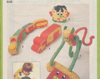 Vintage 1970s sewing pattern - Children's soft toys: telephone, clock, monkey, truck, train