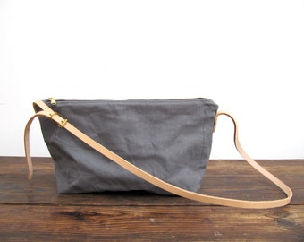 Sale now 25% off. Grey washed canvas crossbody bag. Nude leather adjustable skinny strap with brass buckle. A perfect every day bag.