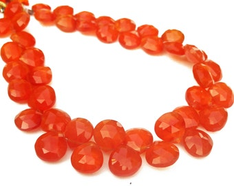 Carnelian faceted briolettes.  Approx. 8.5x8.5mm - 9x9mm.   Select a quantity.