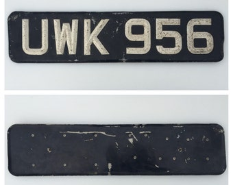 vintage heavy duty ace peak die cast british license plate black with white letters numbers