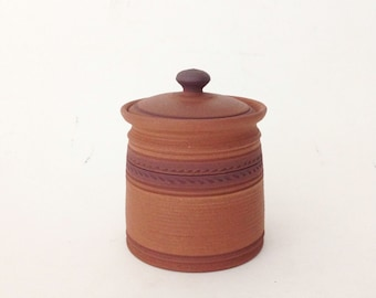 Hand Crafted Ceramic Jar with Iid and Carved Design