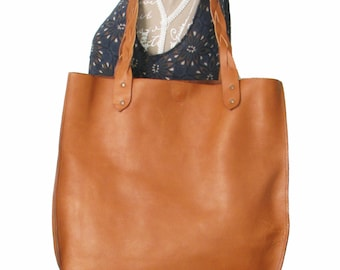 Handmade cognac leather tote bag with braided handles