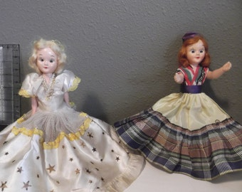 Six Vintage Arco dolls of the World and one older doll.