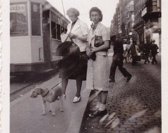 Vintage Snapshot Photo - Two Ladies Standing In Street - Terrier Dog - Tram - Advertising