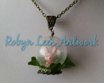Snow Dusted Cute Pink Cartoon Rabbit Globe Necklace with Fake Leaf on Bronze Crossed Chain