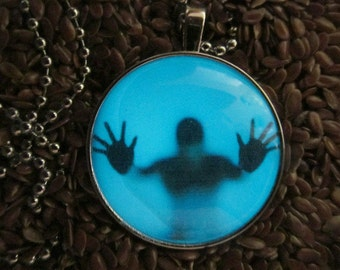 Glow in the Dark Steampunk Man Trapped in the Fog Necklace Round Glows Blue GN 9