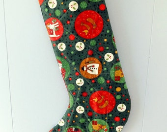 Christmas quilted stocking with snowmen, dogs and reindeer, handmade lined green and red  Christmas stocking with tag