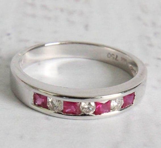 floating ruby diamond white gold wedding band