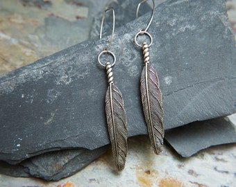 Tafne Silver Navajo Feather Earrings. Long Silver Native American feather Earrings. Tribal boho chic earrings. By Molax Chopa Tribe.