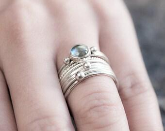 Blue topaz ring. Sterling silver and topaz elegant stackable ring set of 4.