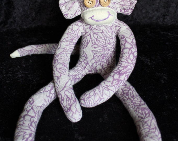 Featured listing image: Sock Monkey / Organic Cotton / Wood Button Eyes / Purple and Ecru Flower Pattern / Organic Gift for Children and Adults / Organic Baby Gift