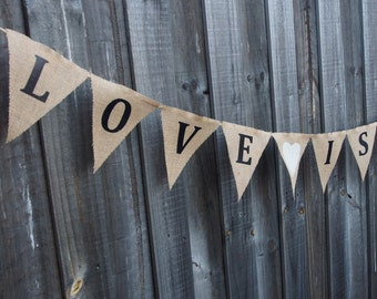 Burlap / Hessian 'LOVE IS SWEET' with hearts. Wedding or engagement decorations. Photo prop