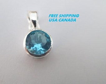 Blue cubic zirconia pendant; 92.5 sterling silver